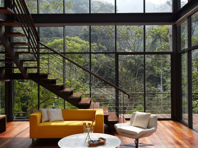 Tropical-House-Design-Interior-with-Glass-Wall-and-Wooden-Floor