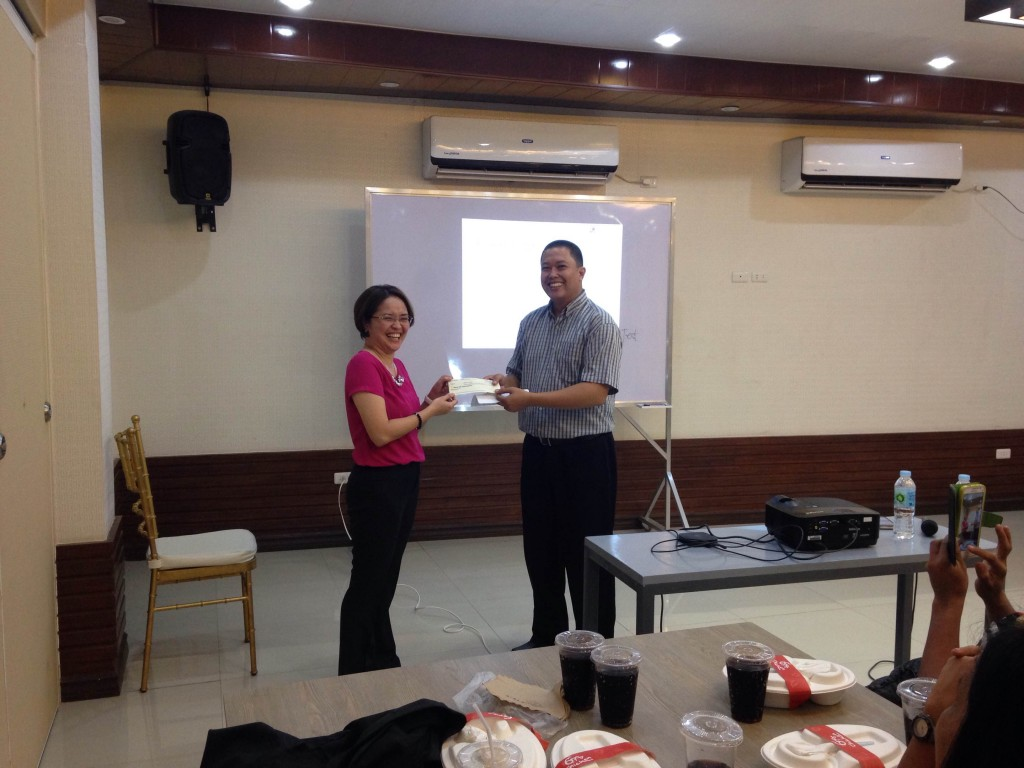Ms. Mayette Baclayon receiving her commission.